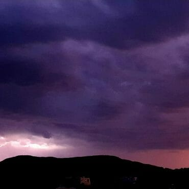 Thunderstorm, lightning and purple clouds
