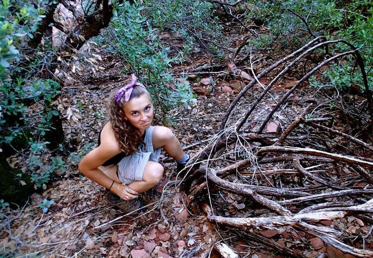 woman peeing in the bush